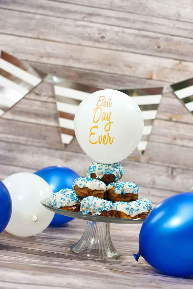 white balloon on top of cupcake